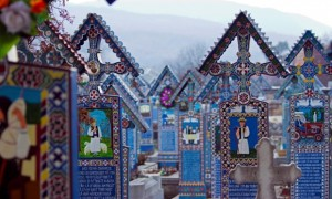 Merry Cemetery in Sapanta, Romania: Unusually for a cemetery, the brightly painted headstones present a less sombre view of death. Colourful portraits of the people buried there and scenes from their lives are on show. Photograph: tomastoica/GuardianWitness