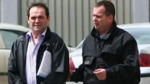 Mihai Necolaiciuc dus de polițiști în arest Foto: obiectiv.info